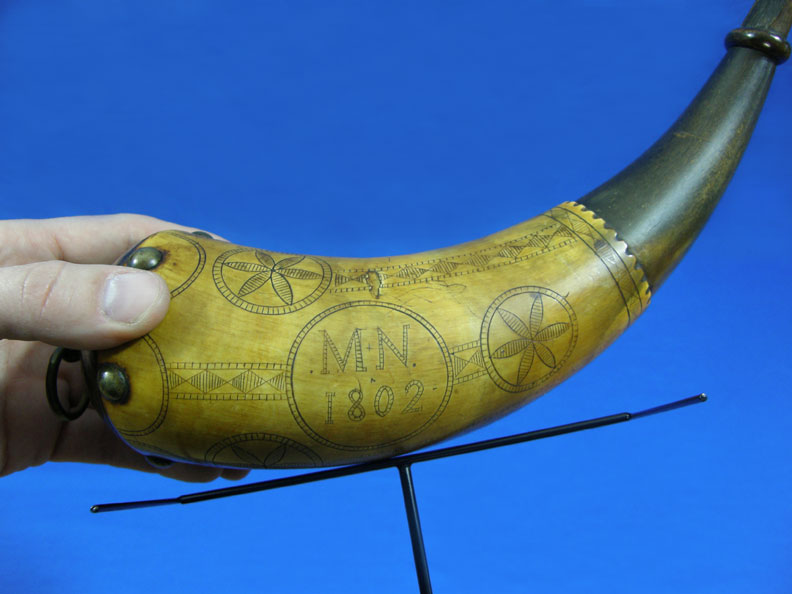 powder horn on display stand by ADE